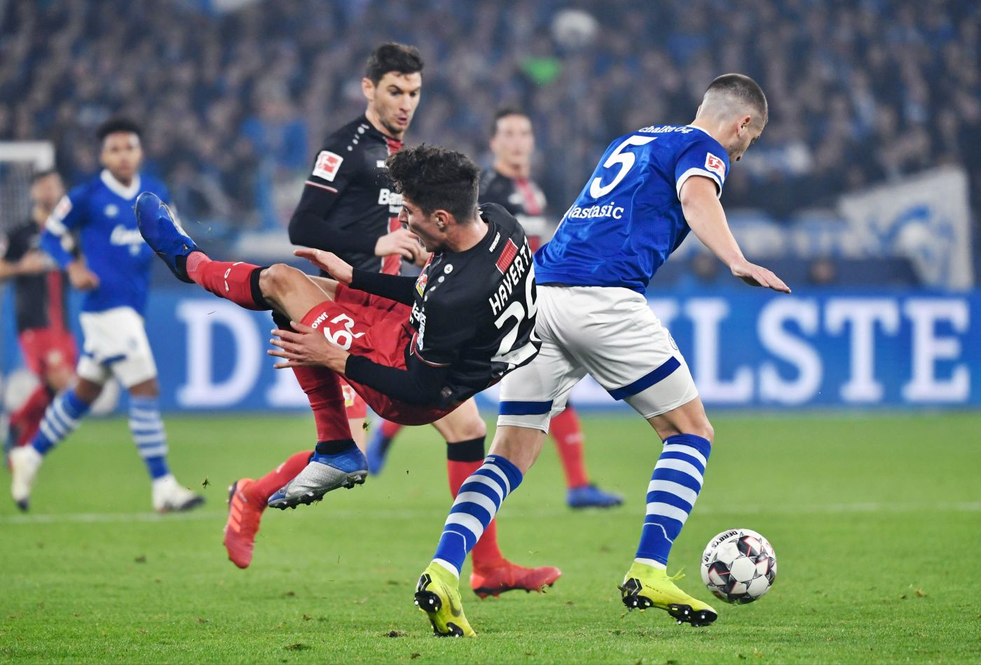 -- Schalke's Serbian defender Matija Nastasic and Leverkusen's German midfielder Kai Havertz (l) vie for the ball during the German first division football match between FC Schalke 04 and Bayer Leverkusen on December 19, 2018.  - Germany OUT / DFL REGULATIONS PROHIBIT ANY USE OF PHOTOGRAPHS AS IMAGE SEQUENCES AND/OR QUASI-VIDEO / AFP / dpa / Ina Fassbender / DFL REGULATIONS PROHIBIT ANY USE OF PHOTOGRAPHS AS IMAGE SEQUENCES AND/OR QUASI-VIDEO